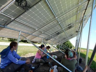 students take a lunch break while surveying pollinator habitat near Cedar Rapids