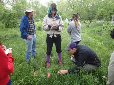 Students take notes while volunteer Bruce Stiles gives them a tour of his property.