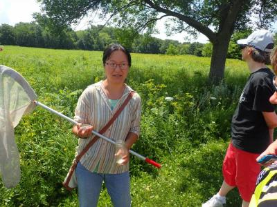 Professors Mark Myers and Ai Wen supervise students on a UNI campus prairie survey