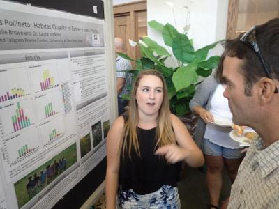 The Summer Undergraduate Research poster session.  Gabrielle Brown with Dr. Mark Myers