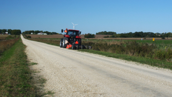 Mowing a ditch in Bremer County
