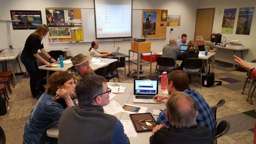 Members of the Ag Conservation Working Group work with the Iowa Prairie Seed Calclulator.