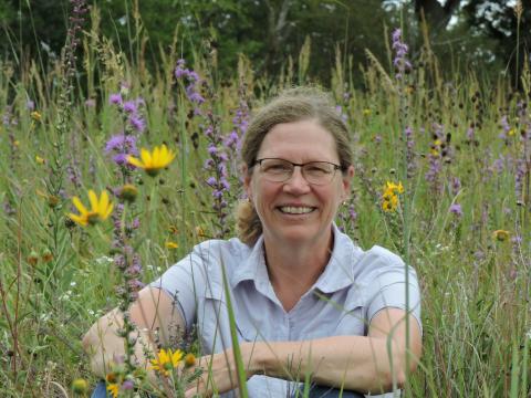 Laura Jackson sitting in a prairie