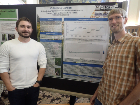Dr. Elgersma with student and poster