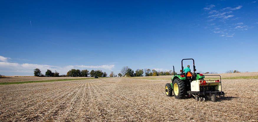 Tractor and drill in field.